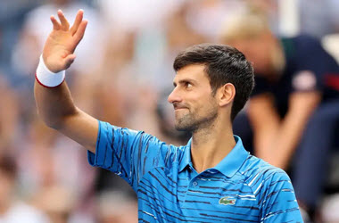 Novak Djokovic Advances to Second Round, Bouchard Out in First at US Open