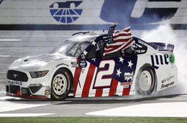 Brad Keselowski takes the checkered flag at the Coca-Cola 600